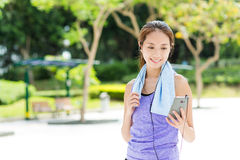 Sporty girl listen to music after running Royalty Free Stock Photos