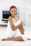 Sporty girl on living room floor Royalty Free Stock Photography
