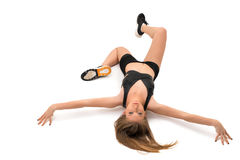Sporty girl lying on the floor shot from above Royalty Free Stock Image