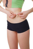 Sporty girl measure waist. Isolated Royalty Free Stock Photo