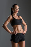 Sporty girl with muscles stock photos