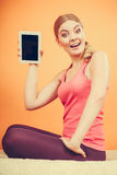 Sporty girl with pc tablet. Blank screen copyspace Stock Photography
