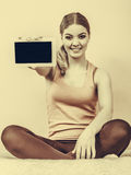 Sporty girl with pc tablet. Blank screen copyspace Royalty Free Stock Images