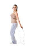 Sporty girl plus size doing exercise with jump rope. Royalty Free Stock Photography
