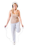 Sporty girl plus size doing exercise with jump rope. Stock Photos