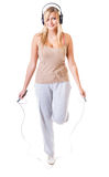 Sporty girl plus size doing exercise with jump rope. Royalty Free Stock Image