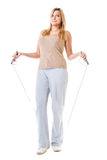 Sporty girl plus size doing exercise with jump rope. Royalty Free Stock Photo
