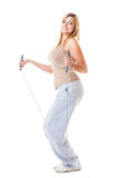 Sporty girl plus size doing exercise with jump rope. Stock Image