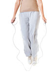 Sporty girl plus size doing exercise with jump rope. Stock Photo
