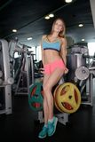 Sporty girl posing in gym Stock Images