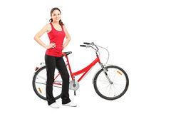 Sporty girl posing next to a bike Stock Images