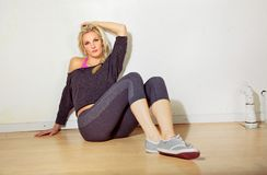 Sporty Girl Relaxing in Gym Royalty Free Stock Photography