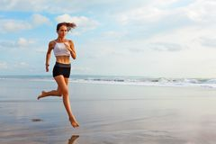 Sporty Girl Running By Beach Along Sea Surf Stock Images