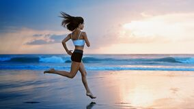 Free Sporty Girl Running By Beach Along Sea Surf Stock Photos - 190322173