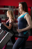 Sporty girl running on treadmill Royalty Free Stock Photo