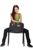 Sporty girl sat on chair Stock Photos