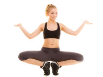 Sporty girl showing blank copy space on hands. Sport and active lifestyle. Full length of fitness sporty girl stretching showing open hands palm with blank copy Stock Photography