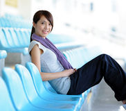 Sporty girl sit in sport arena Stock Photography