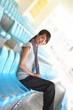 Sporty girl sitting Royalty Free Stock Image