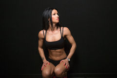 Athletic woman seated Royalty Free Stock Photo