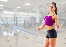 Sporty girl with skipping rope at gym club Stock Photo