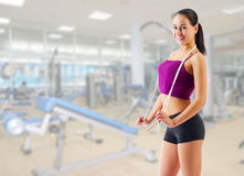 Sporty girl with skipping rope at gym club Royalty Free Stock Image
