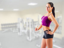 Sporty girl with skipping rope at gym club Stock Images
