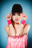 Sporty girl smiling in black baseball cap Royalty Free Stock Photo