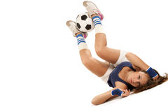 Sporty girl with a soccer ball Stock Photos