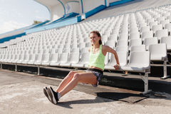 Sporty girl on stadion. Sporty girl on the warm-up, running and working on the stadium. Warming up on the court Royalty Free Stock Images
