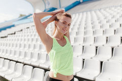 Sporty girl on stadion Stock Photos