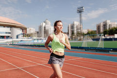 Sporty girl on stadion Stock Photography