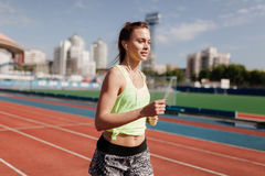 Sporty girl on stadion Royalty Free Stock Photo