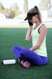 Sporty girl on the stadium Stock Photo