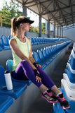 Sporty girl on the stadium Stock Images