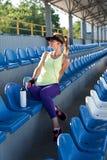 Sporty girl on the stadium Stock Image
