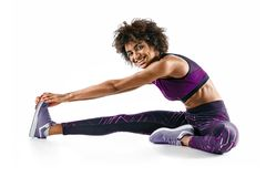 Free Sporty Girl Stretching Her Hamstrings. Royalty Free Stock Image - 105800176
