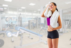 Sporty girl with towel at gym club Royalty Free Stock Photography