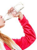 Sporty girl towel on shoulders drinking water Stock Photography