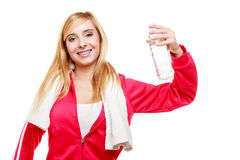 Sporty girl towel on shoulders drinking water Stock Images