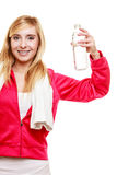 Sporty girl towel on shoulders drinking water Stock Image