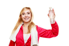 Sporty girl towel on shoulders drinking water Royalty Free Stock Photo