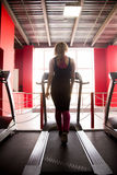 Sporty girl walks on treadmill Royalty Free Stock Images