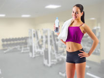 Sporty girl with water bottle at gym club Stock Photography