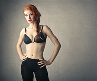A sporty girl. Wearing a black bra and black trousers Royalty Free Stock Photography