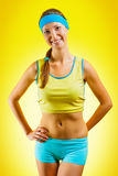 A sporty girl on yellow background Stock Photo