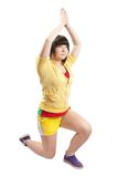 Sporty girl in yellow sportswear. Isolated Stock Photo