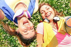 Sporty girlfriends taking selfie break at run training in park. Area - Happy fitness and fun sport concept with joyful young women stock photography