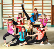 Sporty girls. Group of sporty girls in gym stock photo