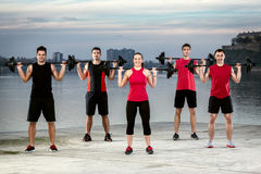 Sporty group with weights Stock Photo
